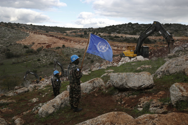Members of UNIFIL, the U.N. peacekeeping force in Lebanon, watch as Israeli construction equipment destroys Hezbollah tunnels dug under the noses of these U.N. troops in violation of two U.N. Security Council Resolutions. U.N. member states fund UNIFIL with $475 million dollars annually.