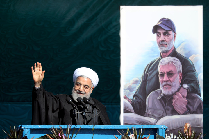 Iranian President Hassan Rouhani beams next to a photo of his henchman, Iranian Major General Qassem Soleimani and Iraqi Shi'ite militia commander Abu Mahdi al-Muhandis—both killed by a U.S. missile. Rouhani is happy a U.N. arms embargo will end in October, but the U.S. is determined to renew the embargo.