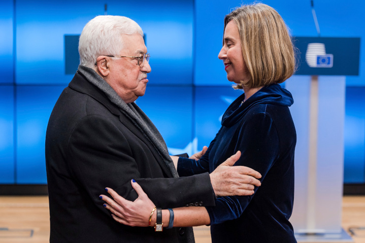 Palestinian President Mahmoud Abbas gets a hug from European Union Foreign Minister Federica Mogherini. EU efforts to make peace between Israel and the Palestinians include funding anti-Semitic Palestinian organizations and schoolbooks and censuring nations intending to locate embassies in Jerusalem.