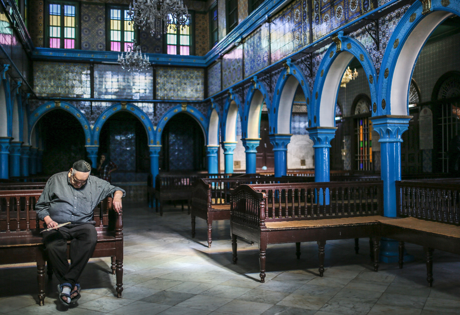 A Jewish man prays in a synagogue on the island of Djerba in Tunisia—one of a handful of Jews remaining in the Arab world after 800,000 were forcibly exiled or fled after their citizenship was revoked by the Arab League in 1946. No aid, compensation or other redress has ever been granted these refugees.