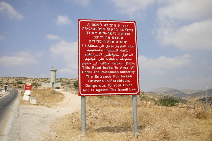 "A sign on the road leading from Area C, near Bardala in the Jordan Valley in Judea-Samaria, to Palestinian-controlled Area A. The sign warns that Israeli citizens may not enter Area A as it is against Israeli law and ""dangerous to your lives."""