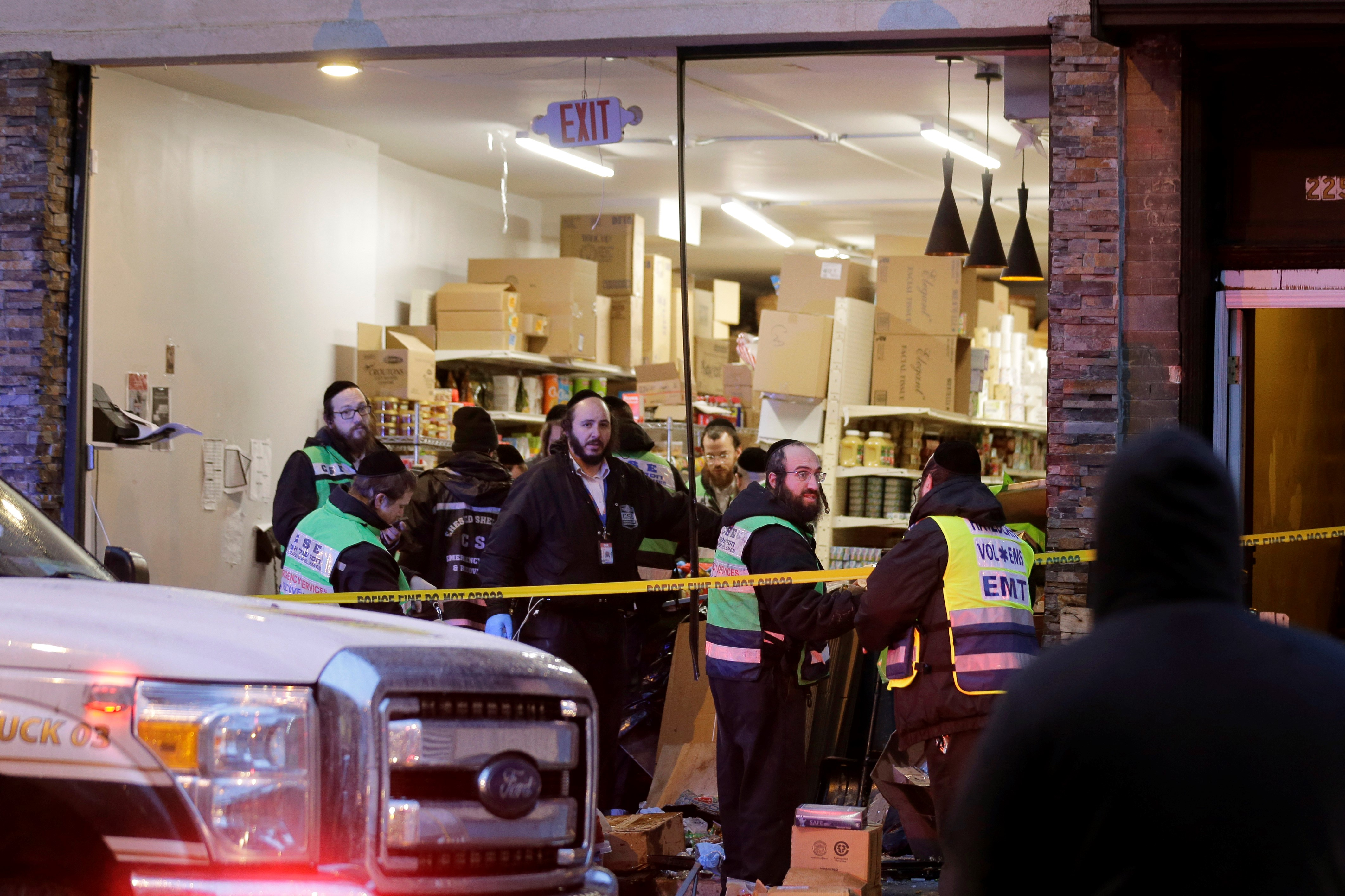 First responders in Jersey City, NJ, after two anti-Semitic killers assaulted a kosher market, murdering three Jews and a police detective. The incident is a violent manifestation of increasing attacks against Jews—often linked to hatred of Israel. Jews are already the most targeted group for hate crimes in the United States.